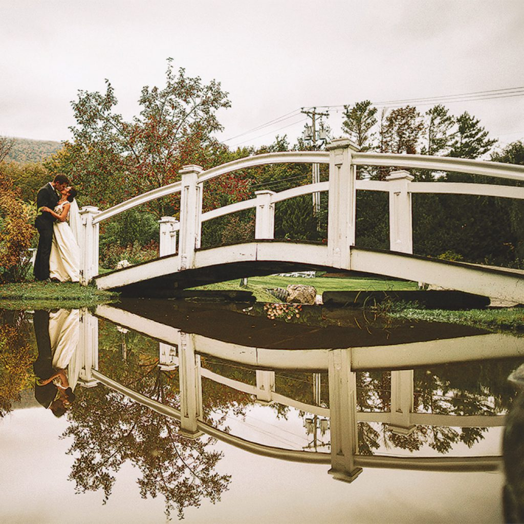 kissing bride by the bridge